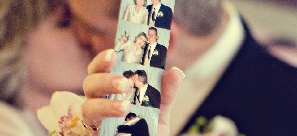 Bride and Groom with Photo Booth Pictures
